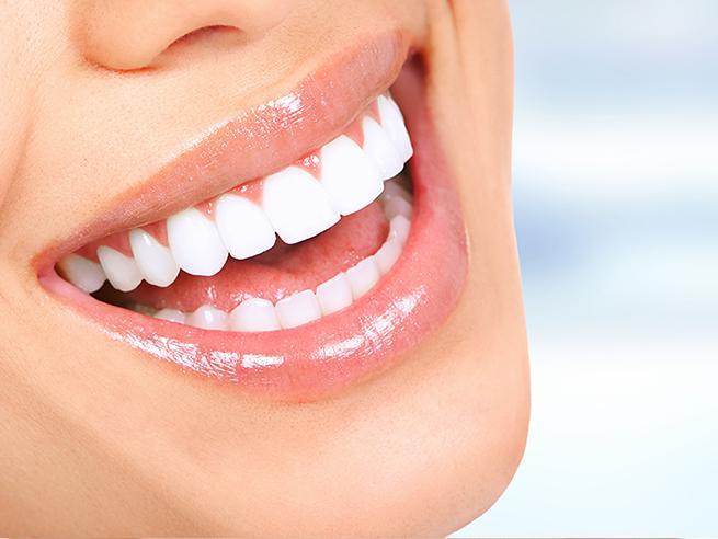 white teeth through teeth cleaning